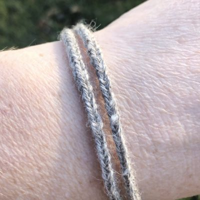 woman wearing gray bracelet